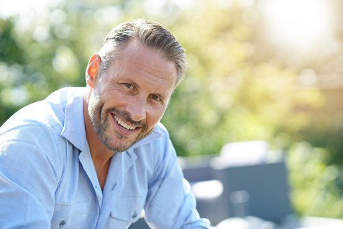 Portrait of smiling mature man relaxing outside